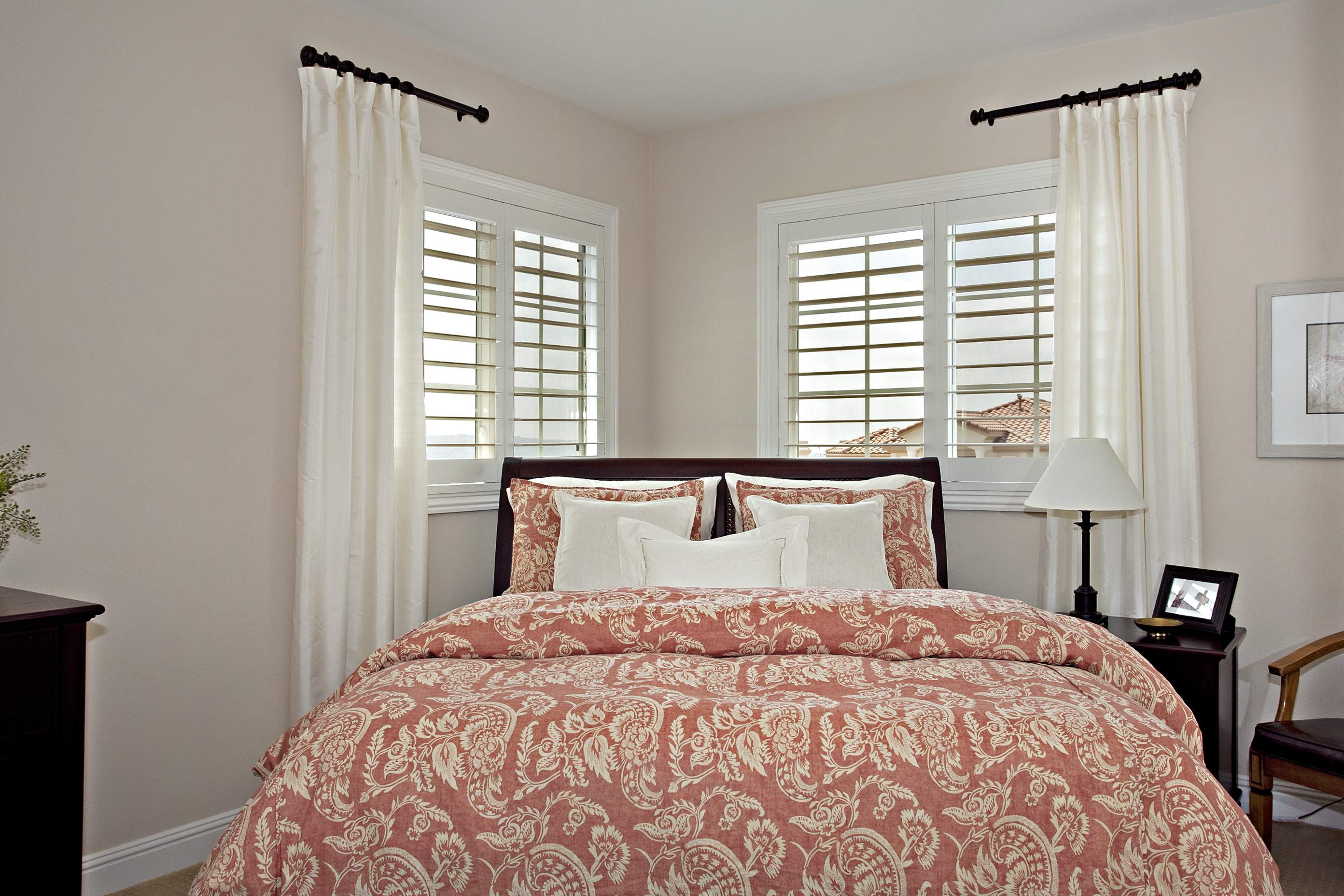 Shutters with decorative panels and handle cutout